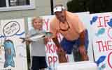 Peter Deely holding his 2.275 lb blue next to Darrin, Snapper Derby organizer
